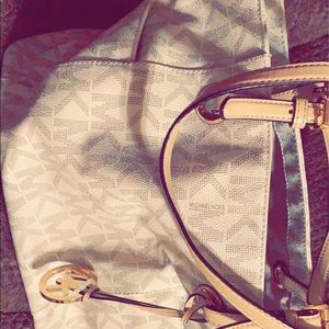 Micheal Kors purse and Coach wallet